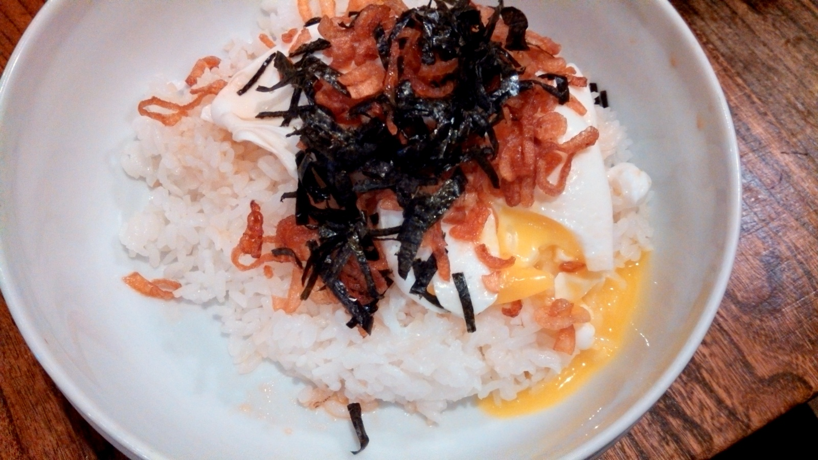 Golden poached eggs over rice with fried shallots and nori at 903 ; a ...
