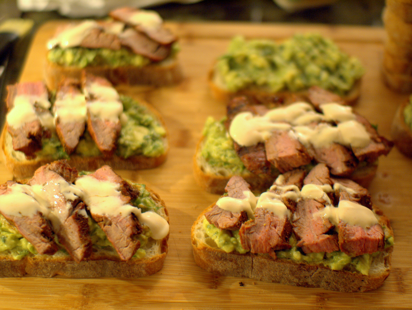 grilled flank steak sandwiches with avocado and spicy crema